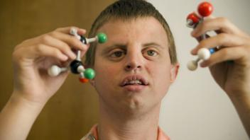 Henry Hoby Wedler, a graduate student in chemistry at UC Davis, demonstrates his molecule builder set, which depicts the structure of ethyl acetate broken into parts. It helps him form a mental image of the chemical bonds. Wedler wishes to go on to teach. Photo taken on September 11, 2011.