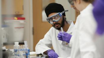 Harpreet Singh talks with other UC Davis students during a Chemistry 2C lab at UC Davis on Tuesday, April 29, 2014.  The students were preforming qualitative analysis on a solution, trying to identify the five cations present.