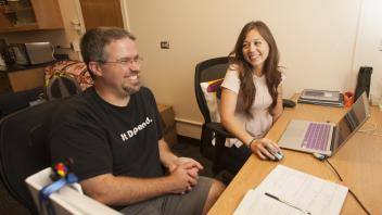 Professor Dean Tantilllo of the chemistry department talks with PhD candidate Brandi Hundson about work on August 31, 2015 at UC Davis.