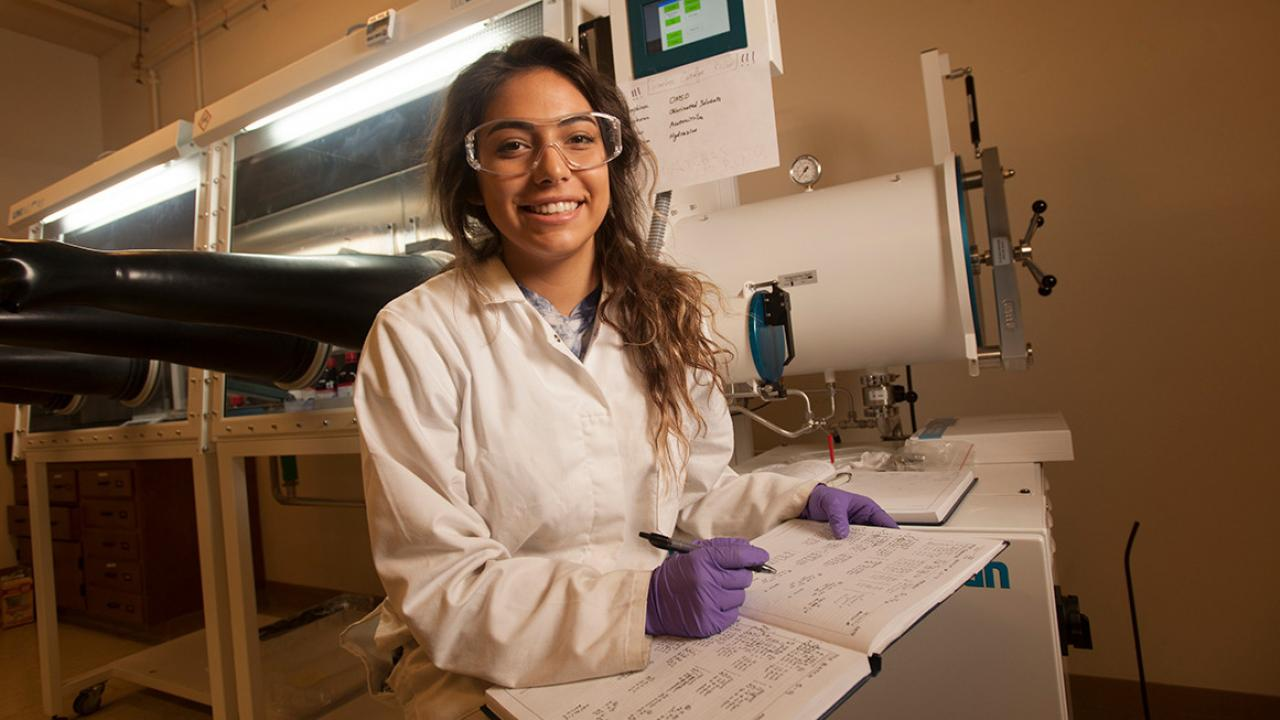 Kaia Yellowhorse, a Native American student from Yreka in Northern California, works in a lab creating nanoparticles for her pharmaceutical chemistry major. She wants to be a professor and run her own lab one day. (Gregory Urquiaga/UC Davis)
