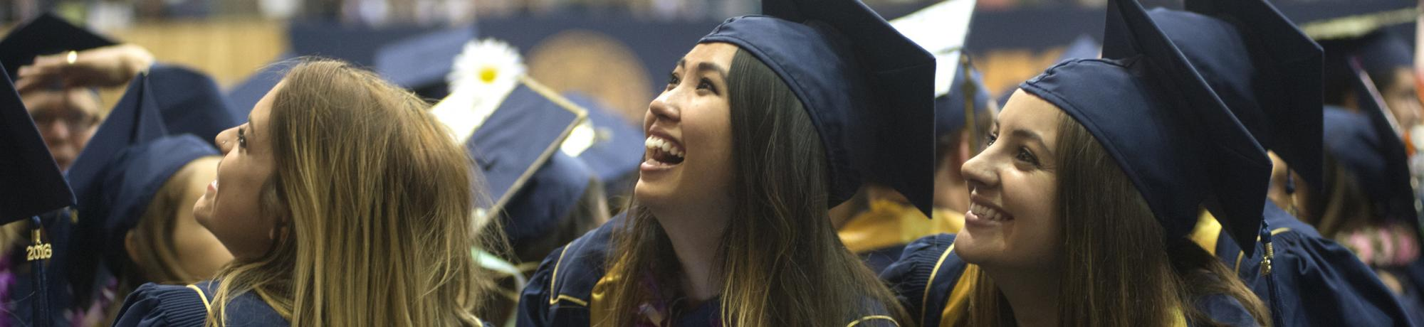 Students call to friends as they walk into the Pavilion during the commencement on Friday June 10, 2016 at UC Davis.
